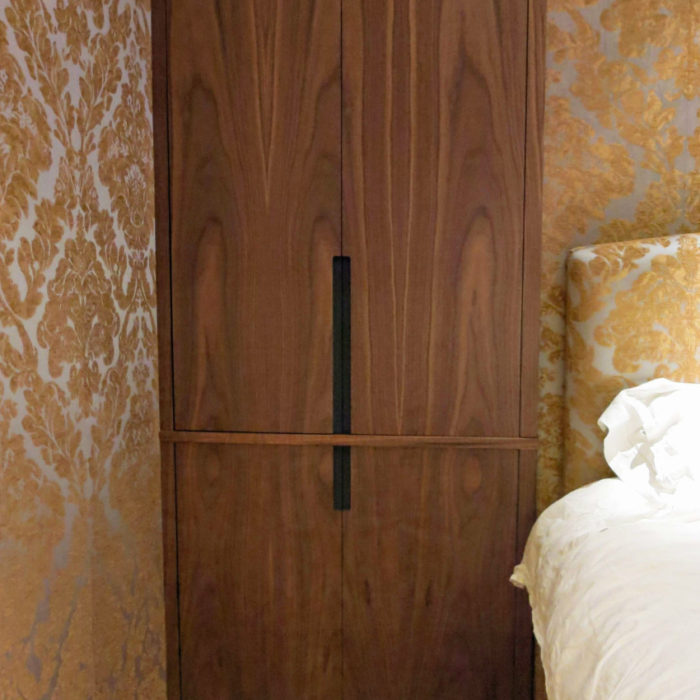 Fitted alcove cupboards, walnut on black valchromat for handle detail