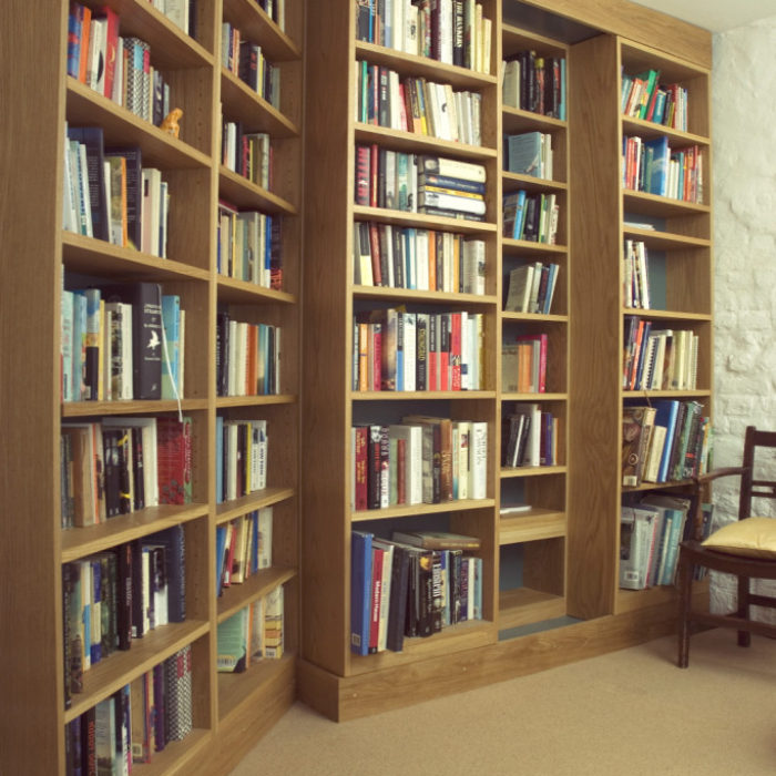 Double depth sliding bookcases in solid oak