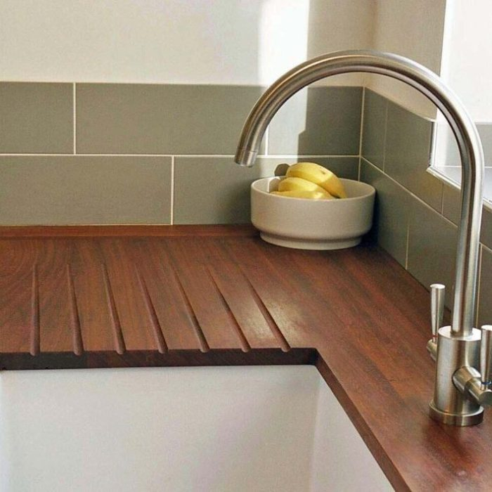 Kitchen worktop made from iroko salvaged from old science workbenches